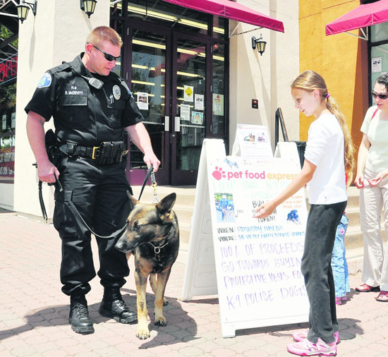 Officer McDevitt and Doc in front of Pet Food Express , Lafayette Photo Andy Scheck